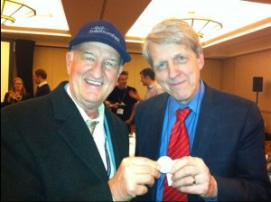 I present Nobel Prize economist Robert Shiller with a silver dollar.